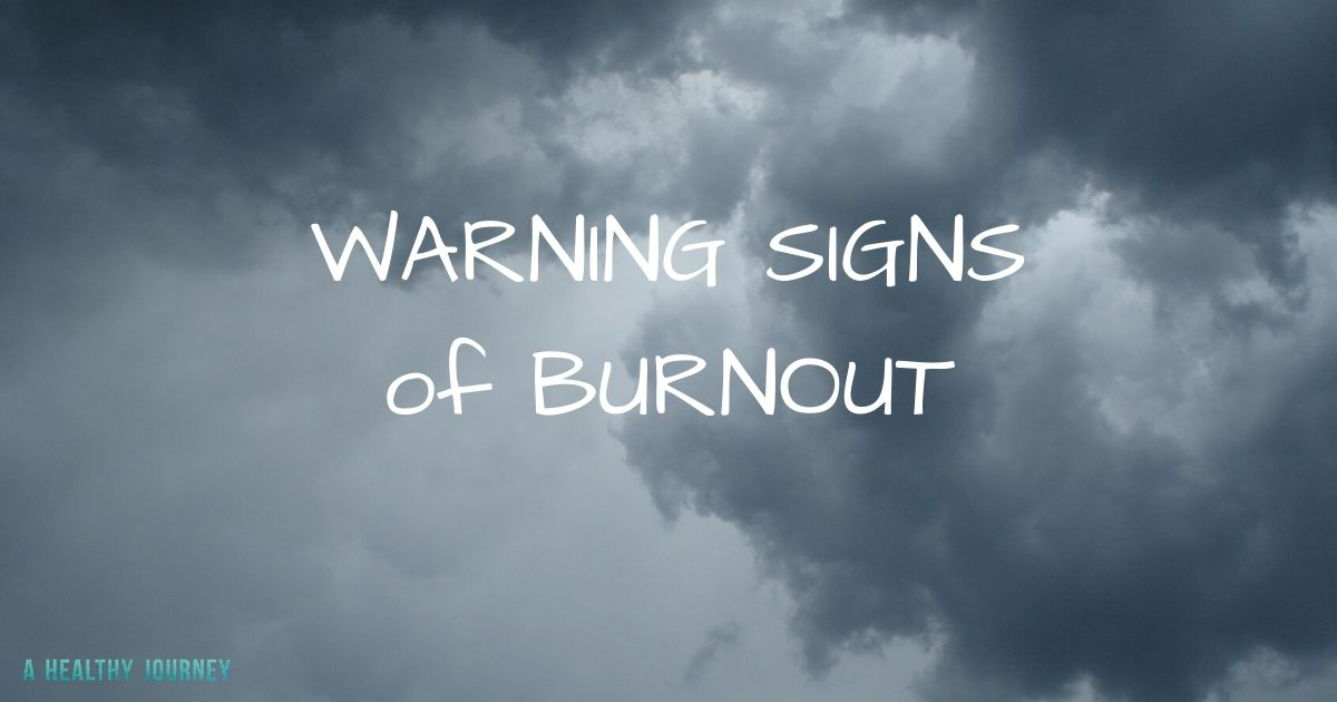 Background of clouds with text: Warning Signs of Burnout